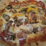 Pizza with Red Sauce and Tomatoes